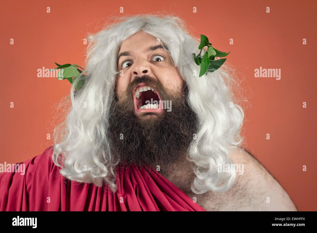 Angry screaming wrath of god against orange background - Stock Image