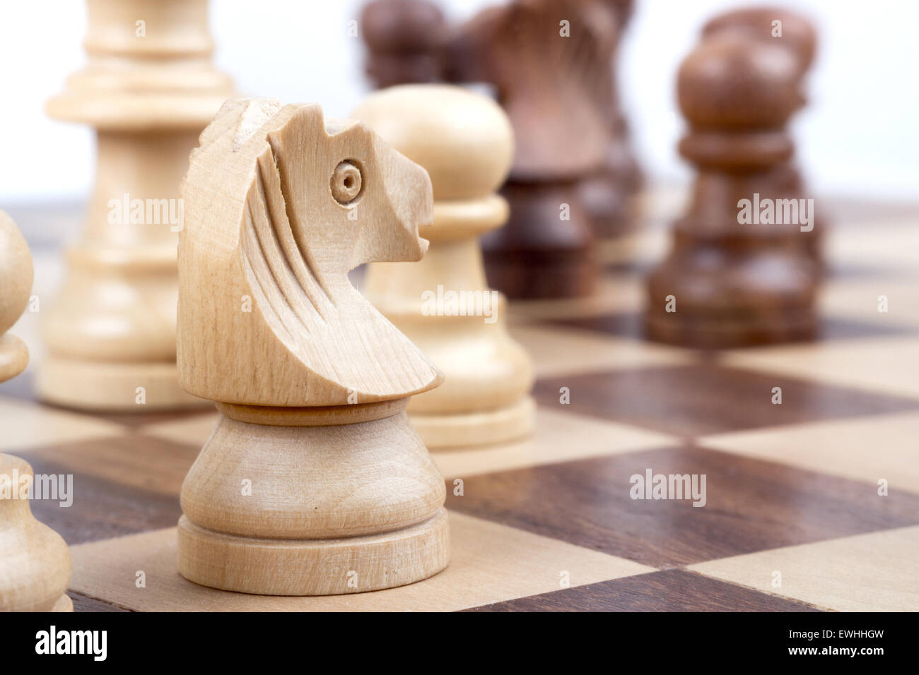 Chess pieces during on a chessboard. - Stock Image
