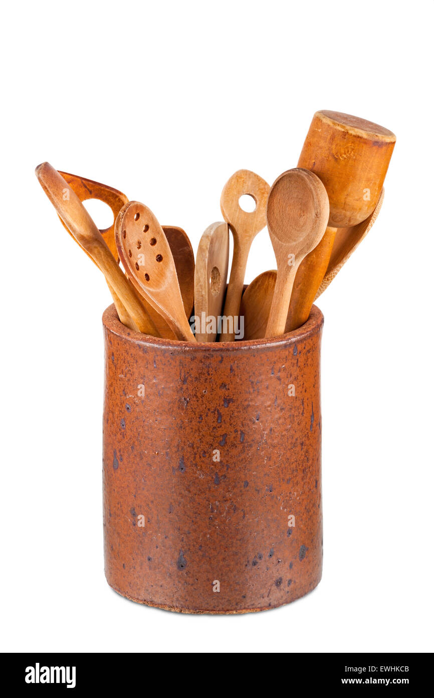 Old clay pot with wooden kitchen utensils isolated on white Background Stock Photo