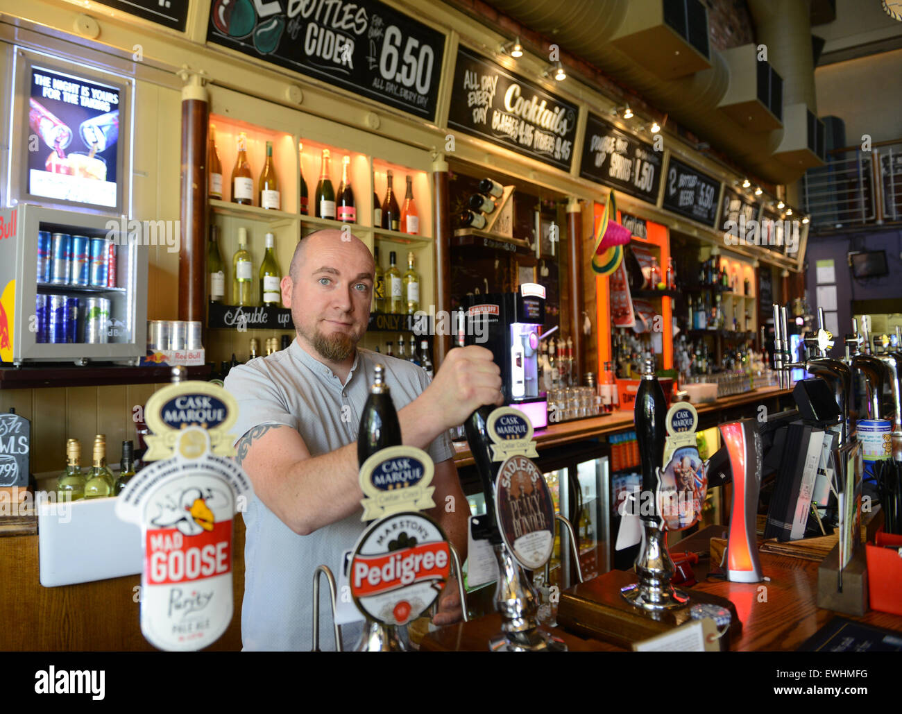 Barman pulling a pint of beer ale at The Castle in Coventry UK - Stock Image