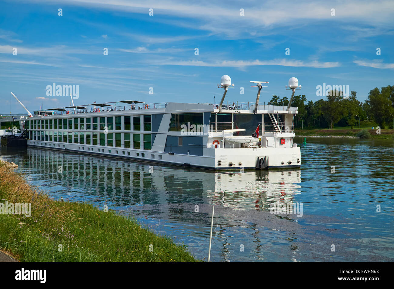 Large passenger ship lies on the banks of of the Rhine at Breisach - Stock Image
