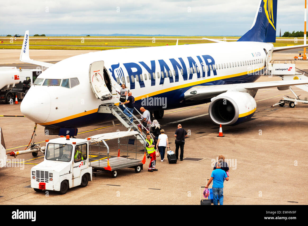 Ryanair plane airlines airline passengers boarding steps East Midlands airport name sign resorts plane aircraft - Stock Image