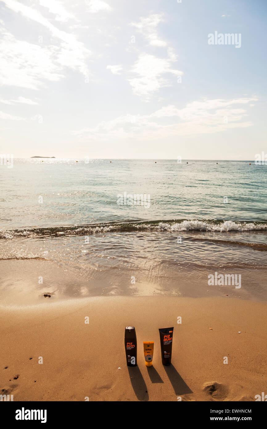 SPF sun protection cream bottles suncream bottle beach summer sea piz buin Ibiza Spain Spanish resort skin cancer - Stock Image