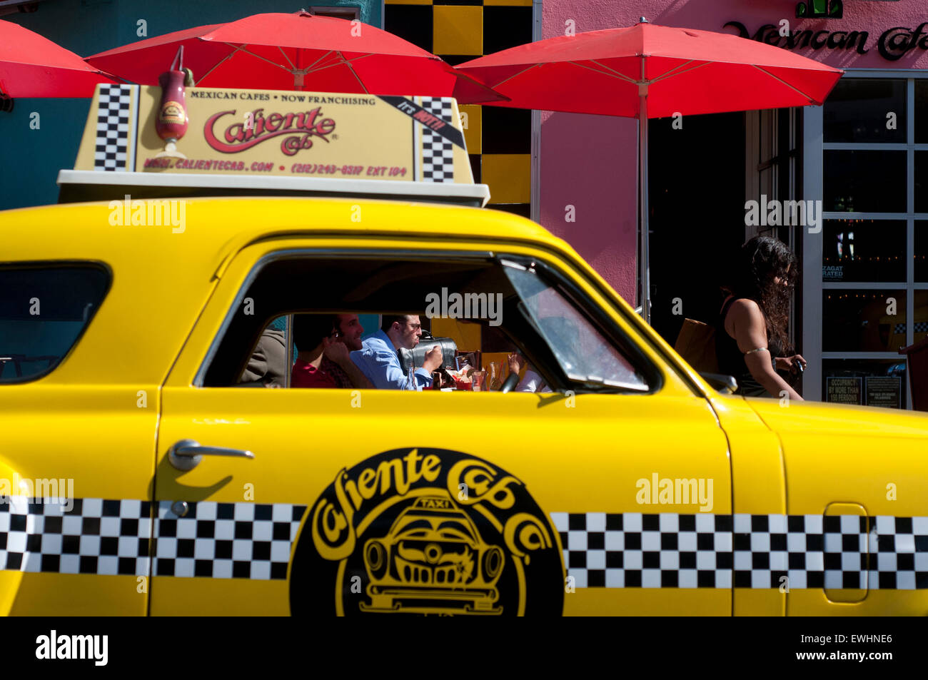 Caliente Cab Restaurant in Greenwich Village. 61 7th Avenue . (from 12:00 p.m. to 2:00 a.m. ) U.S. $ 7-20 . A yellow - Stock Image