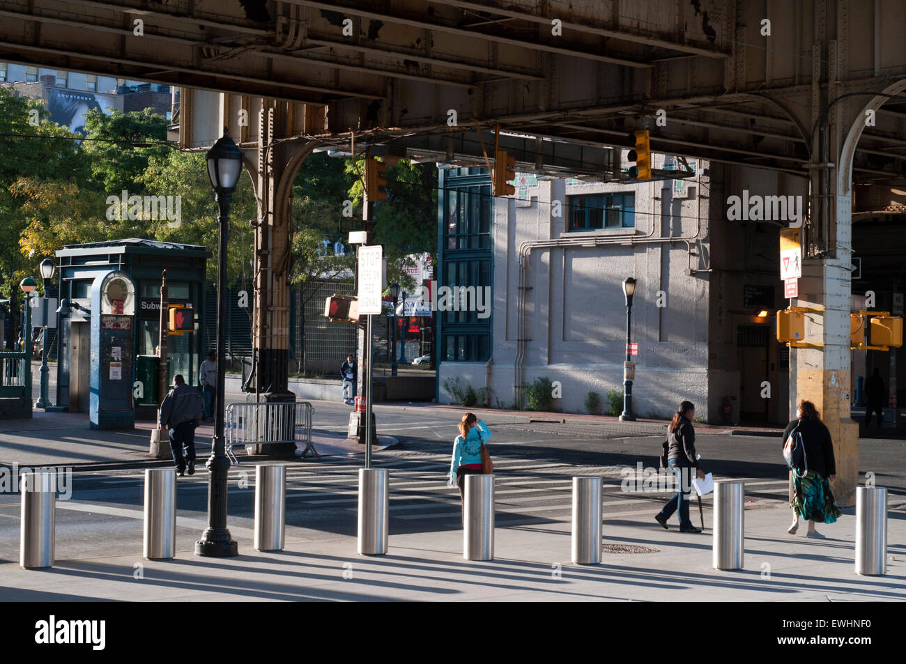 Typical landscape in the Bronx near a elevated metro. Bronx Thinking nothing can make us imagine some friendly faces - Stock Image