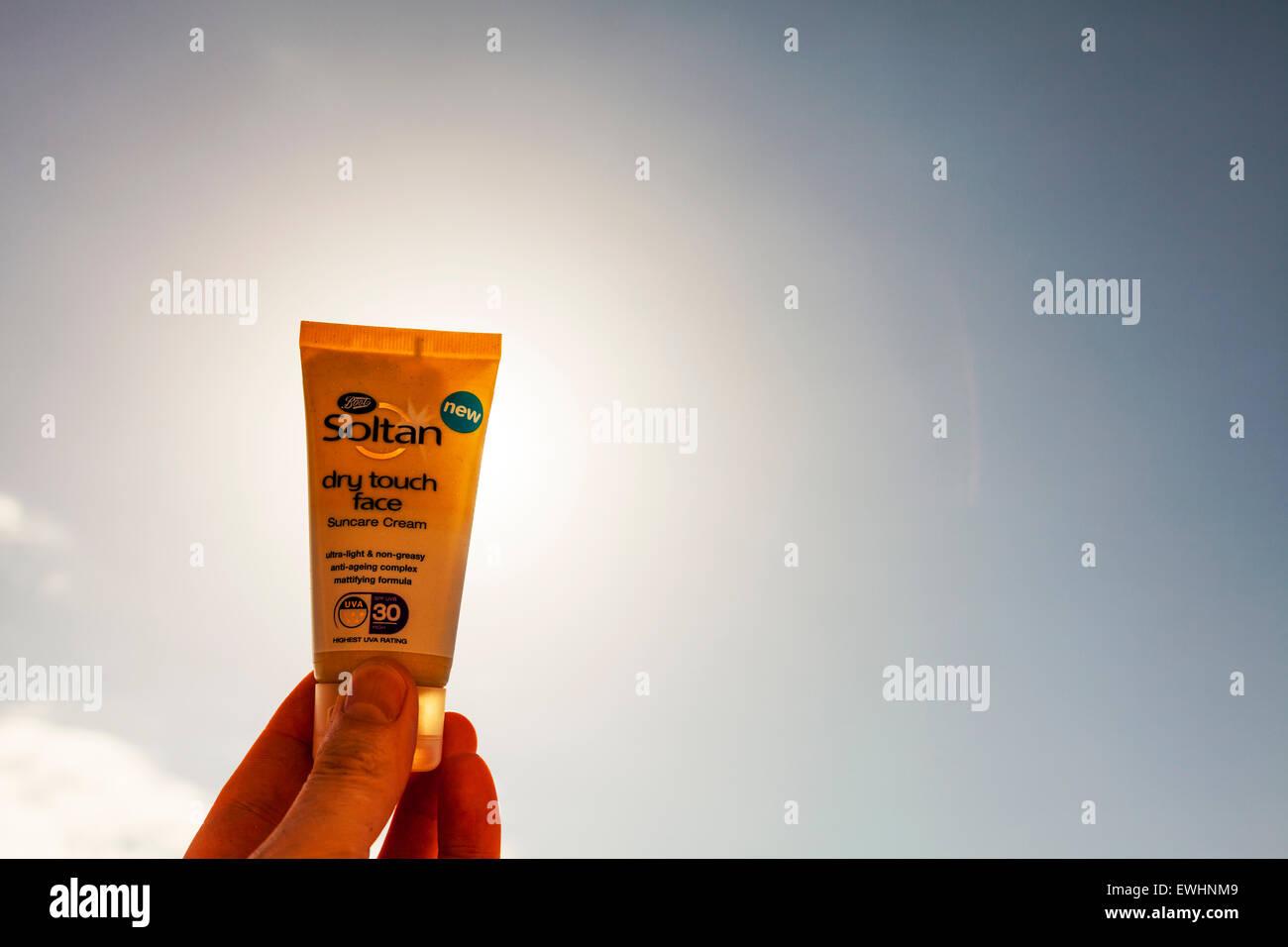 SPF sun protection face cream bottles suncream bottle beach summer sea Soltan Ibiza Spain Spanish resort skin cancer - Stock Image
