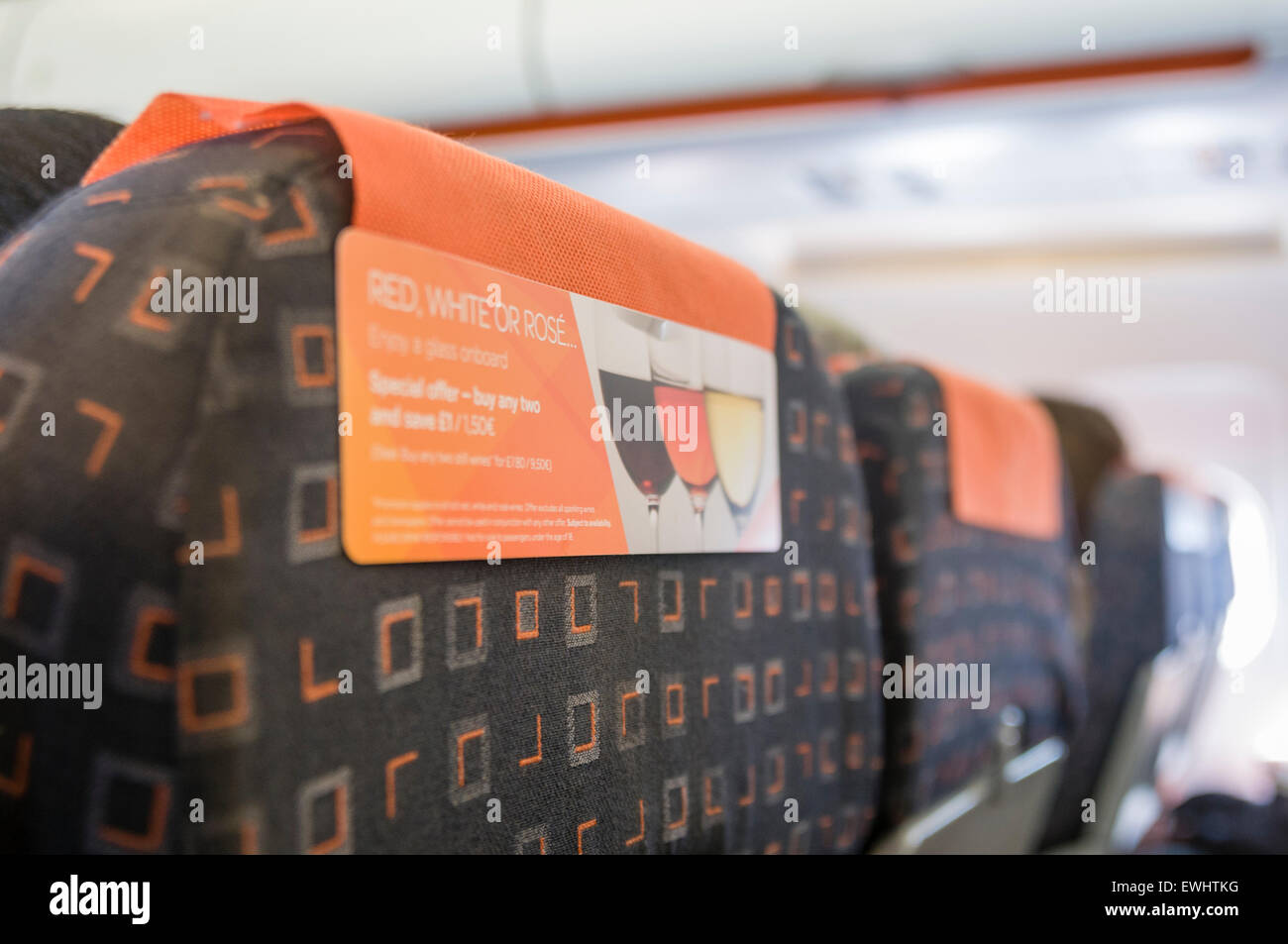 Advertisement on the back of a seat on an Easyjet flight advertising wine for sale. - Stock Image