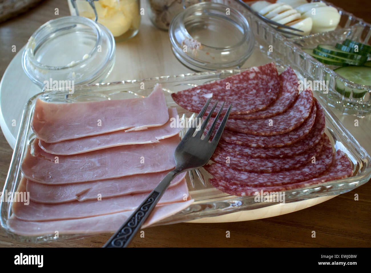 selection of cold meats ham and salami as part of a continental breakfast in a guesthouse Iceland - Stock Image