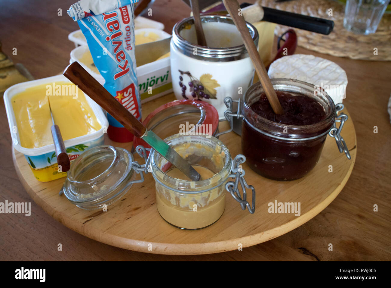 selection of cheeses and spreads for breakfast in a guest house Iceland - Stock Image