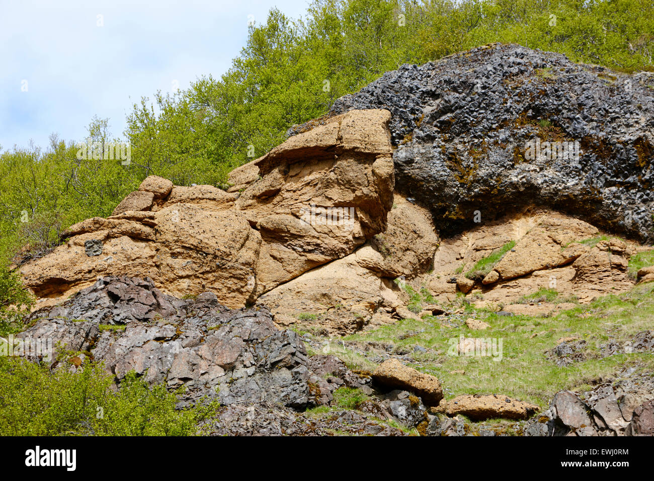 layer of tuff rock on hillside in Iceland - Stock Image