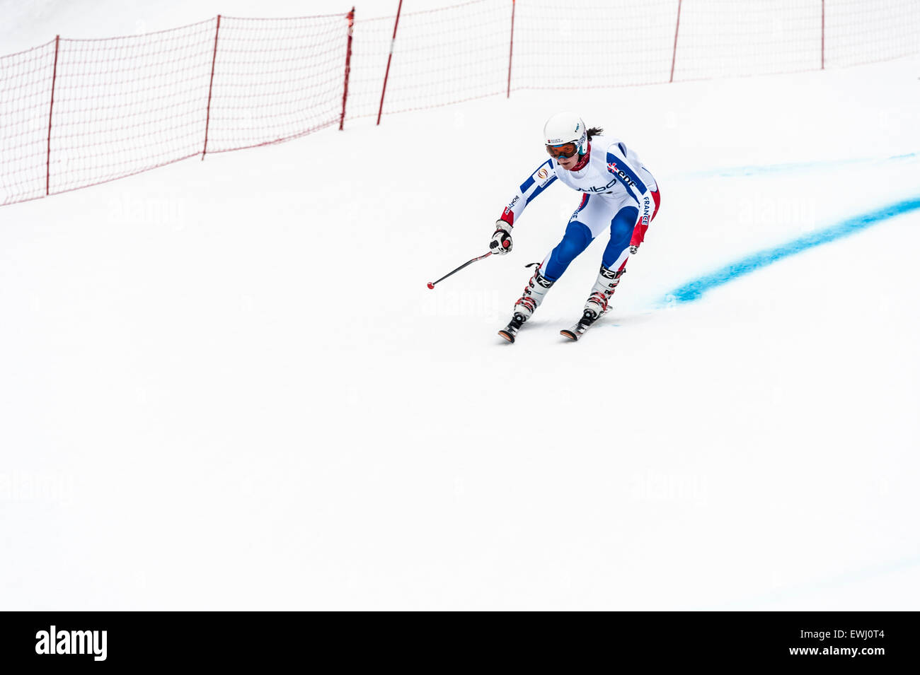 A disabled competitor, with left lower arm amputated, racing downhill in a giant slalom race - Stock Image