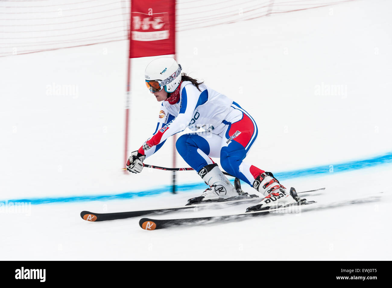 A disabled competitor, with left lower arm amputated, passing through a gate in a giant slalom race - Stock Image