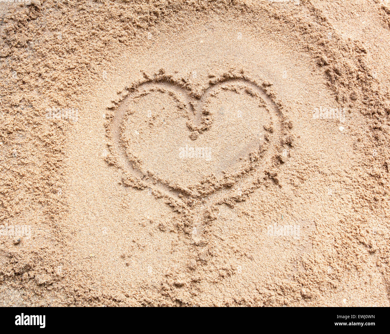 I Love You symbol sand background texture with heart. - Stock Image