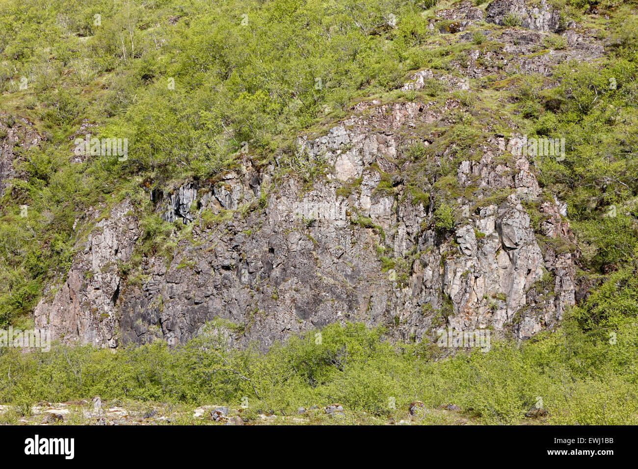 basalt dikes protruding from hillside Iceland - Stock Image