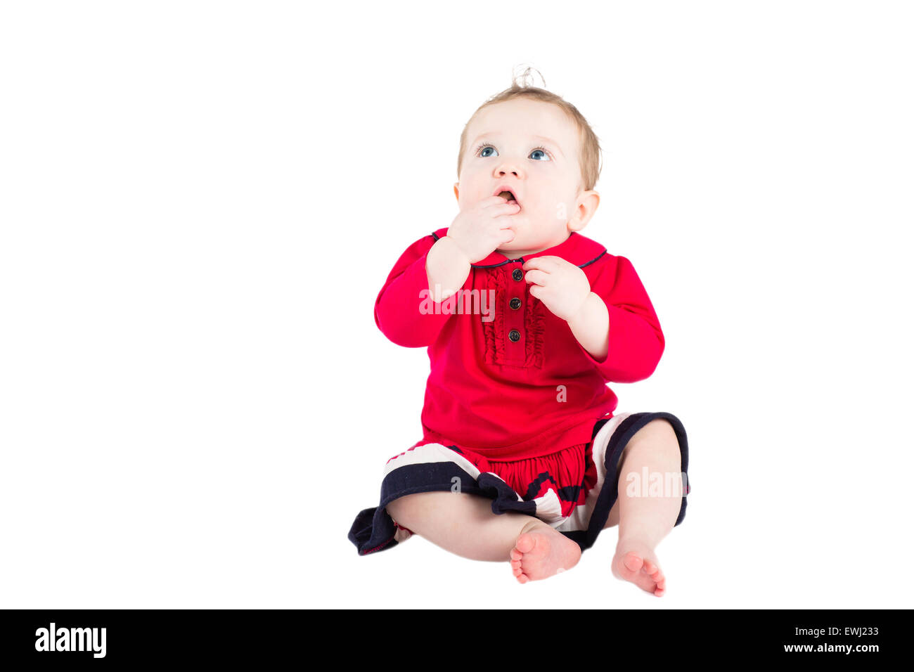 Cute baby girl in a red dress, isolated on white - Stock Image
