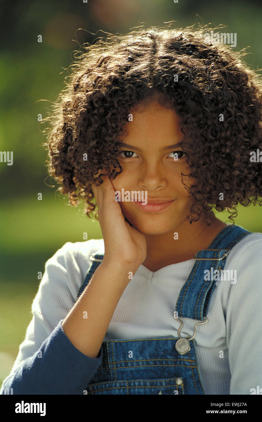 Portrait Of A Young Biracial Girl Outdoors In A Park Stock Image