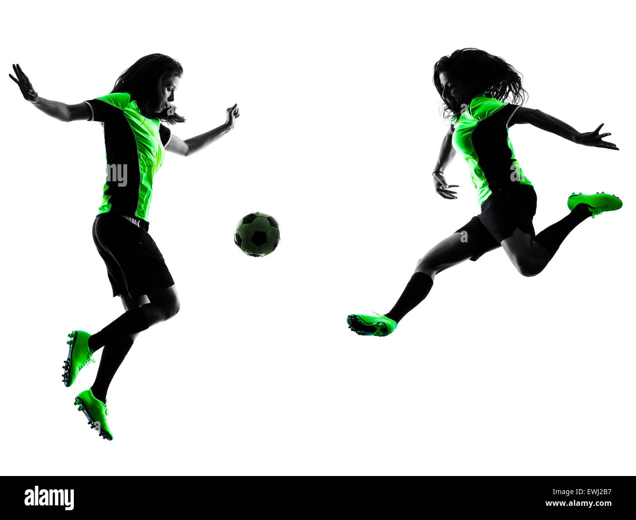 two women playing soccer players in silhouette isolated on white background - Stock Image