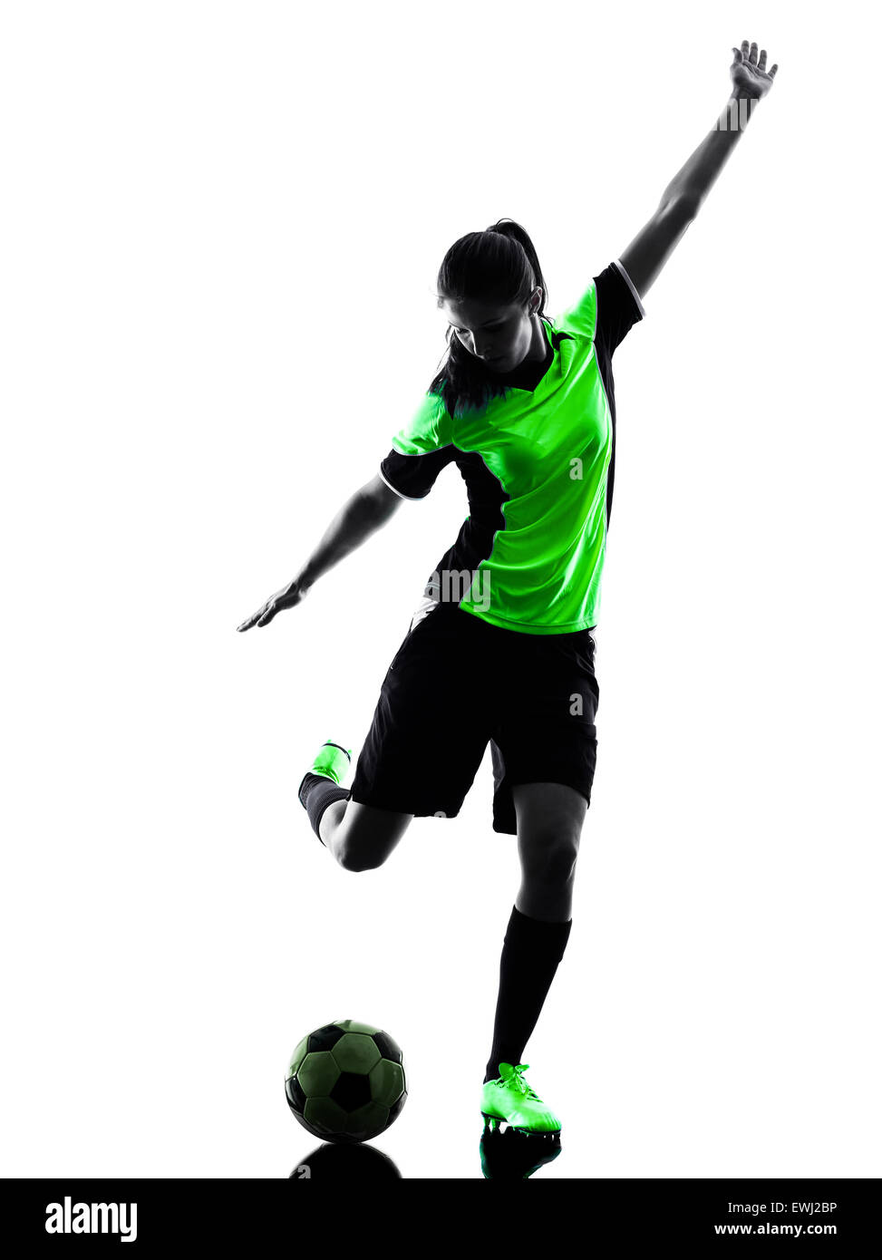one woman playing soccer player in silhouette isolated on white background - Stock Image