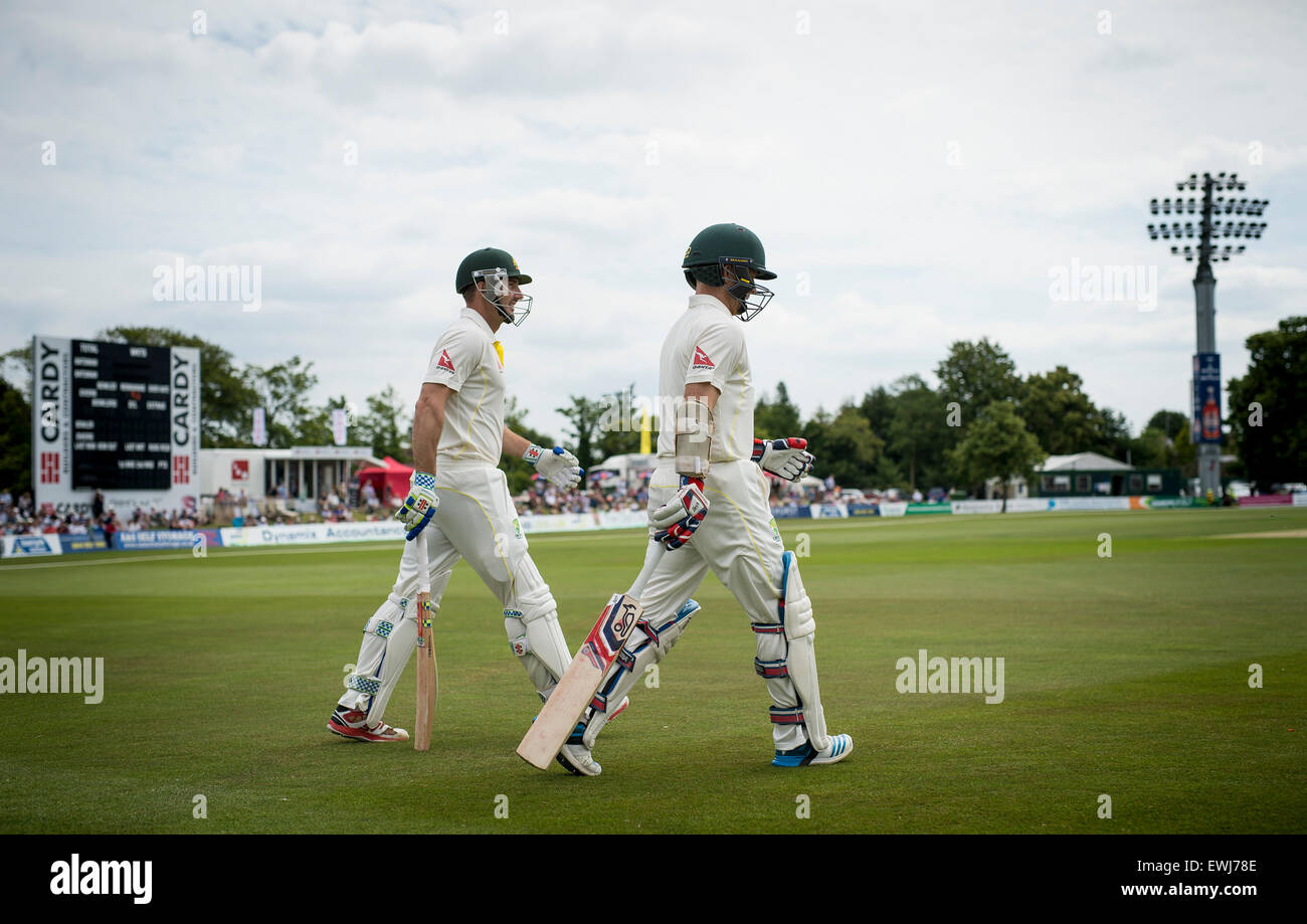 Australia's Shaun Marsh (L) and Chris Rogers walk out to the middle to start the 2015 Ashes tour with the tour match - Stock Image