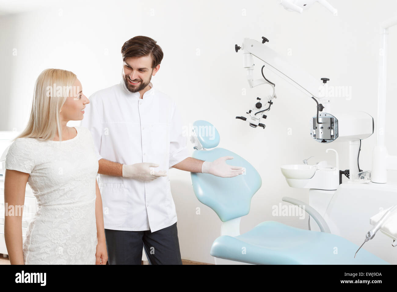 Dentist showing to client working place - Stock Image