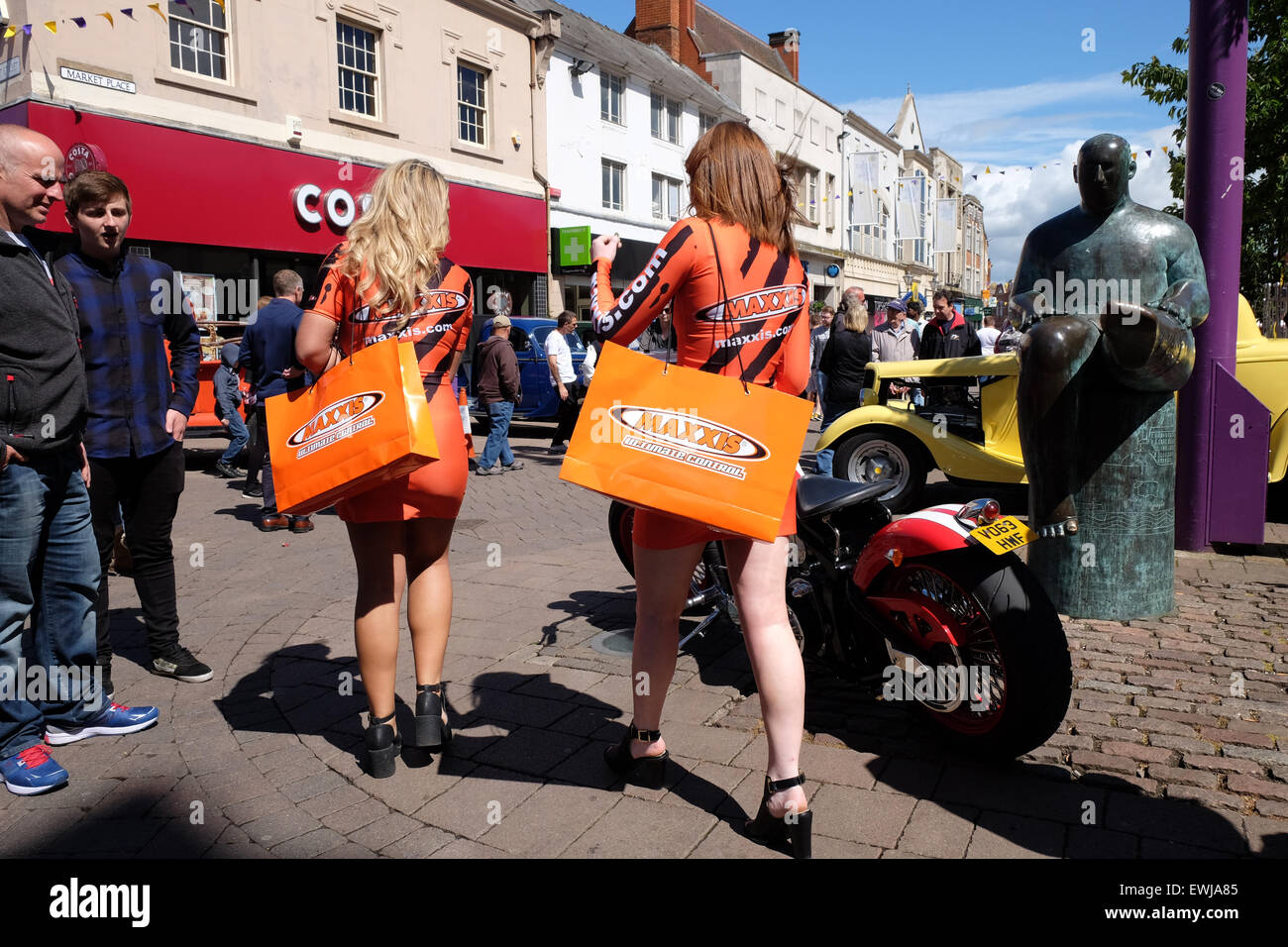 two maxxis girls at the charnwood cruisers classic car show in loughborough - Stock Image