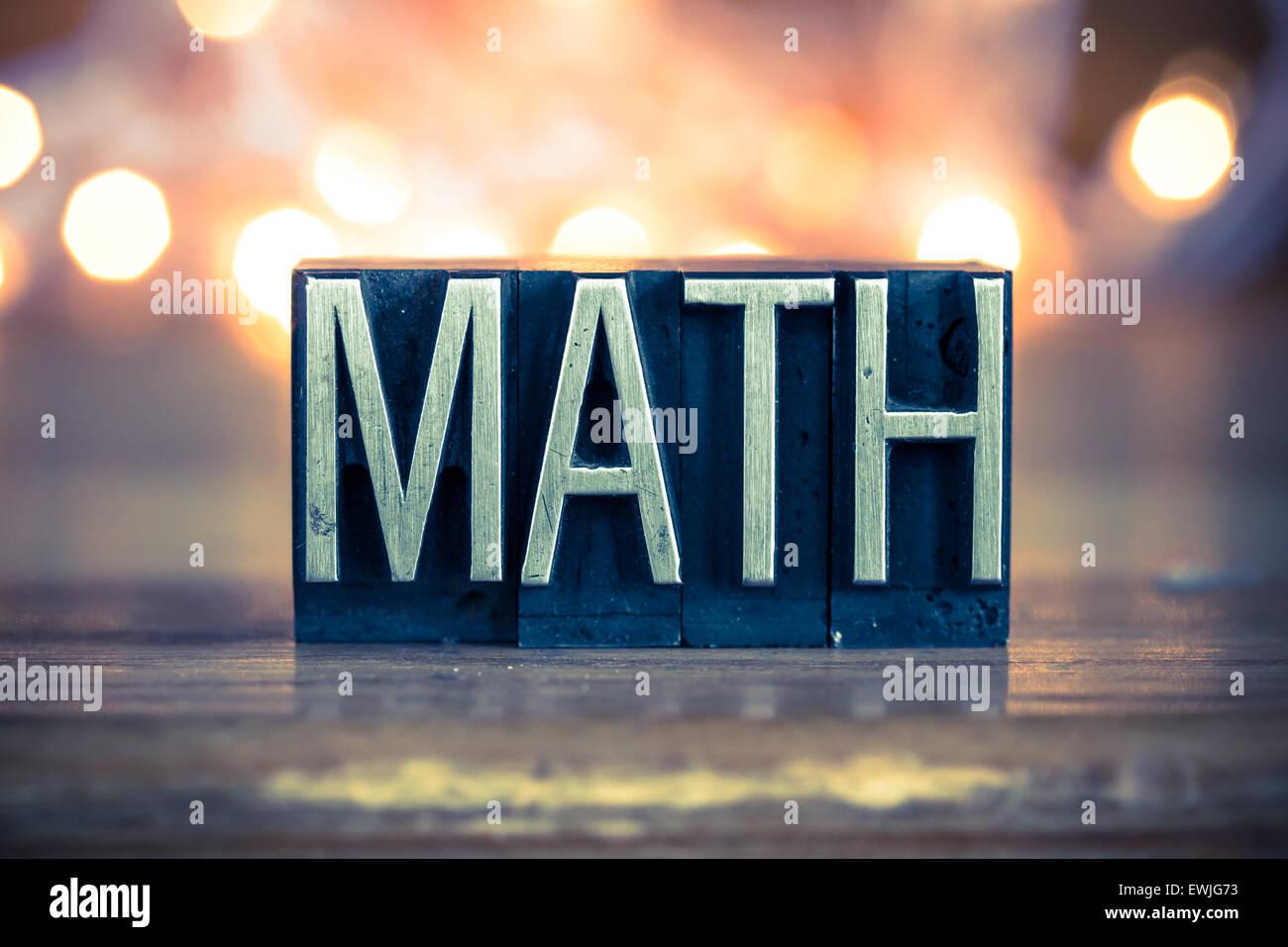 The word MATH written in vintage metal letterpress type on a soft ...
