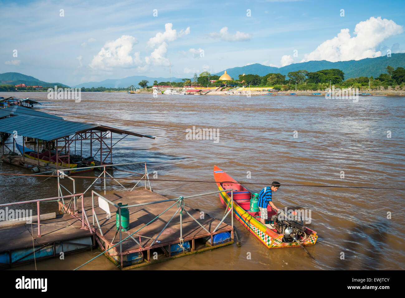 Golden Triangle River Boat with a View of Laos - Stock Image