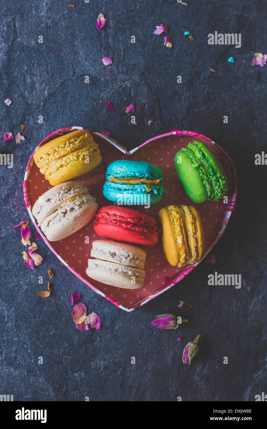 Sweet homemade macaroons cookies in heart shape box,selective focus and blank space - Stock Image