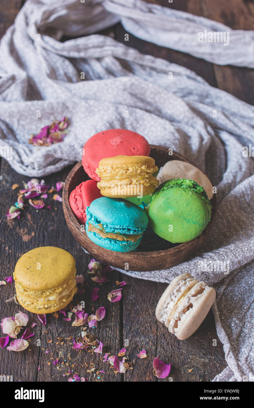 Sweet homemade macaroons cookies in wooden bowl,selective focus and blank space - Stock Image