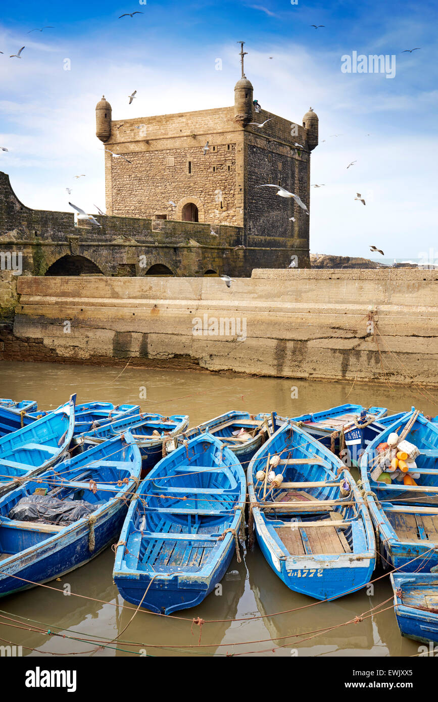 Blue fishing boats in the harbour of Essaouira, Morocco, Africa - Stock Image