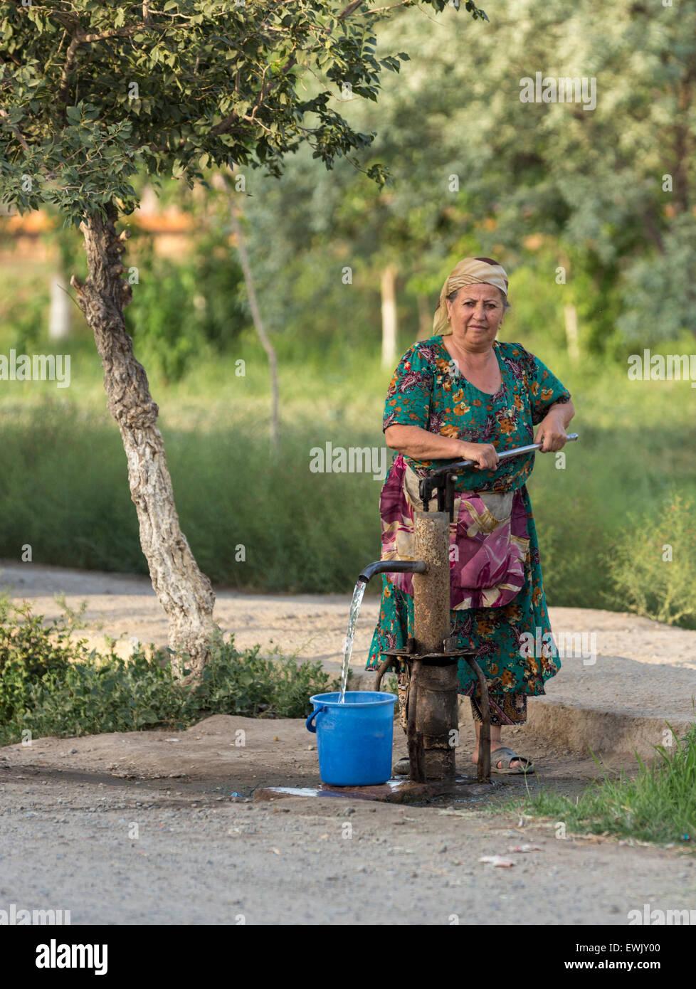 Woman pumping water in Khiva, Uzbekistan - Stock Image