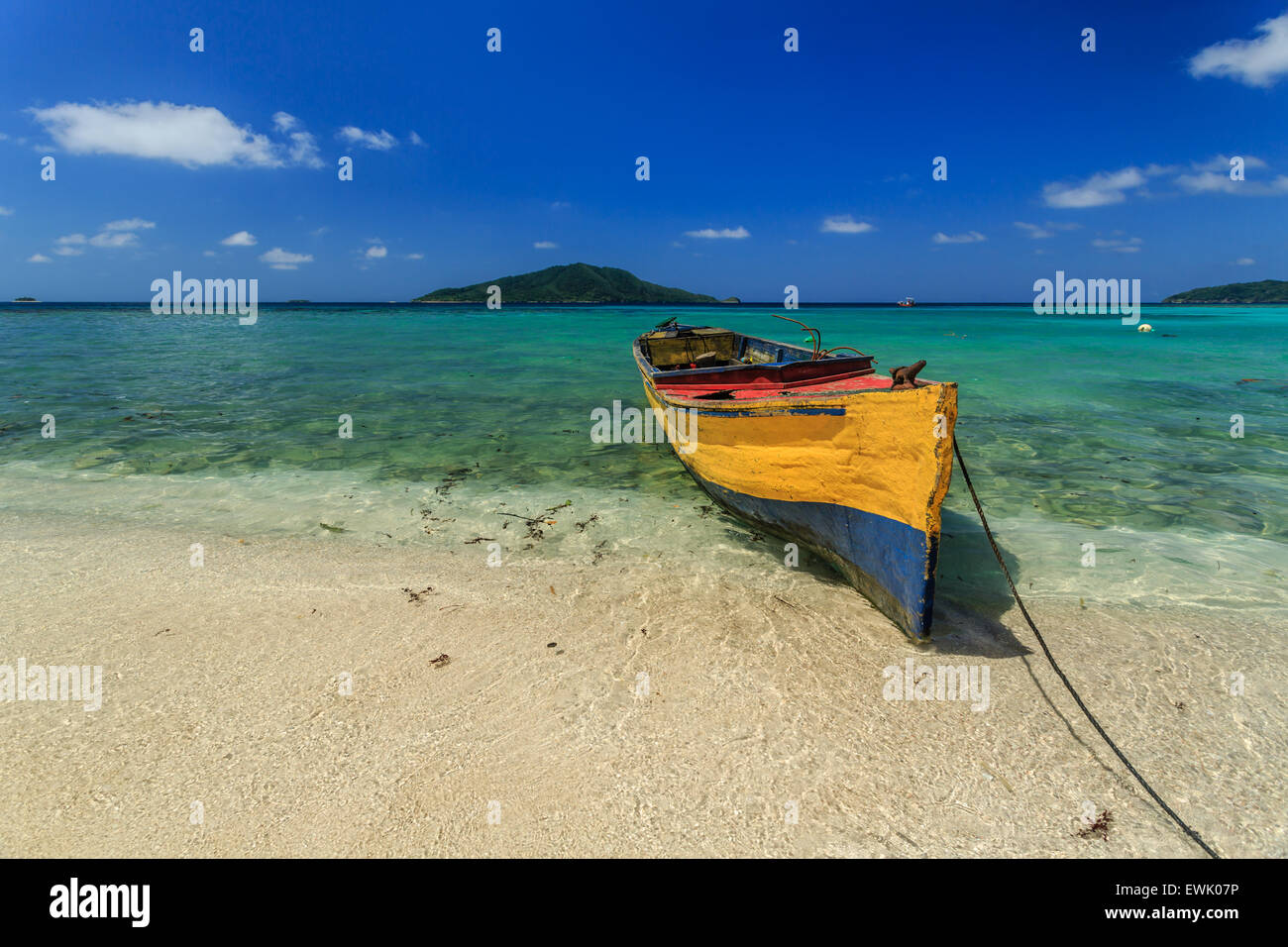Colorful Yellow And Blue Wood Fishing Boat On Tropical Island Beach