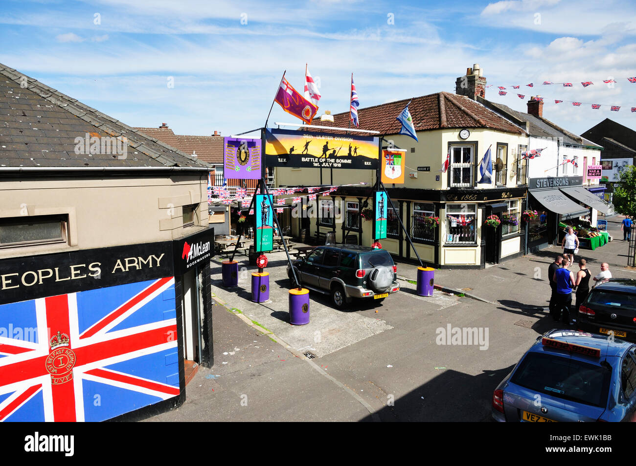 The Rex Bar, open in 1865, is the oldest bar in the Shankhill, West Belfast. The courtyard has memorials to the - Stock Image