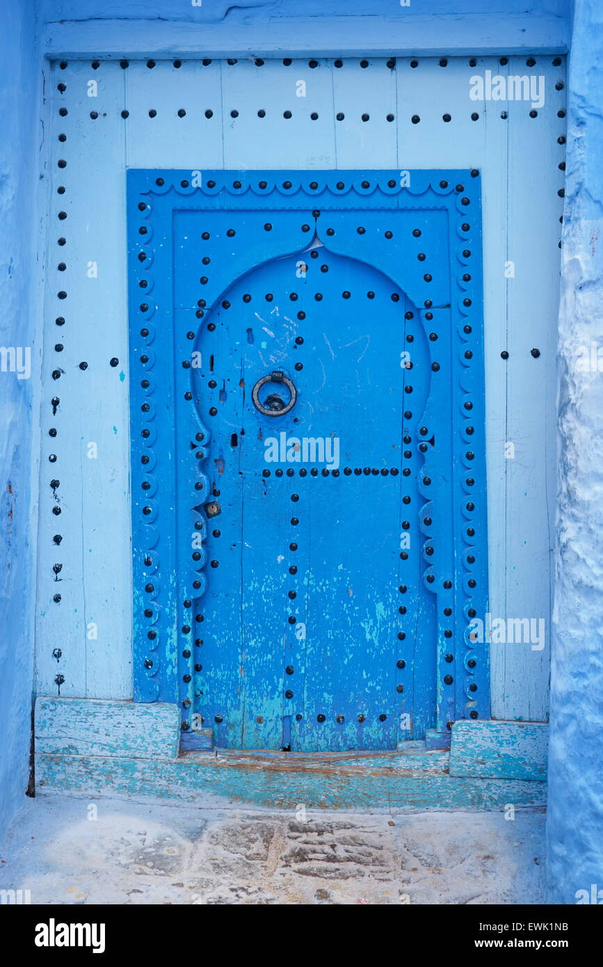Blue painted door in old medina of Chefchaouen, Morocco, Africa - Stock Image