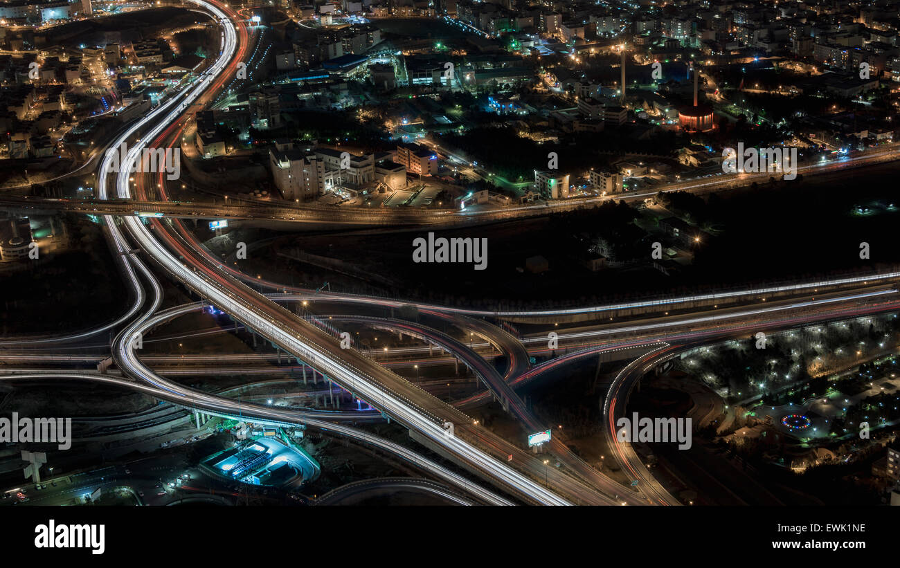 Freeway overpasses seen from Milad Tower at night, Tehran, Iran - Stock Image