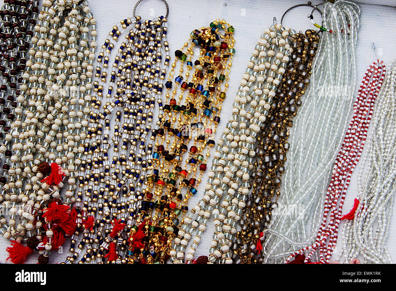 Display of variety of colorful, white and transparent beaded necklaces - Stock Image