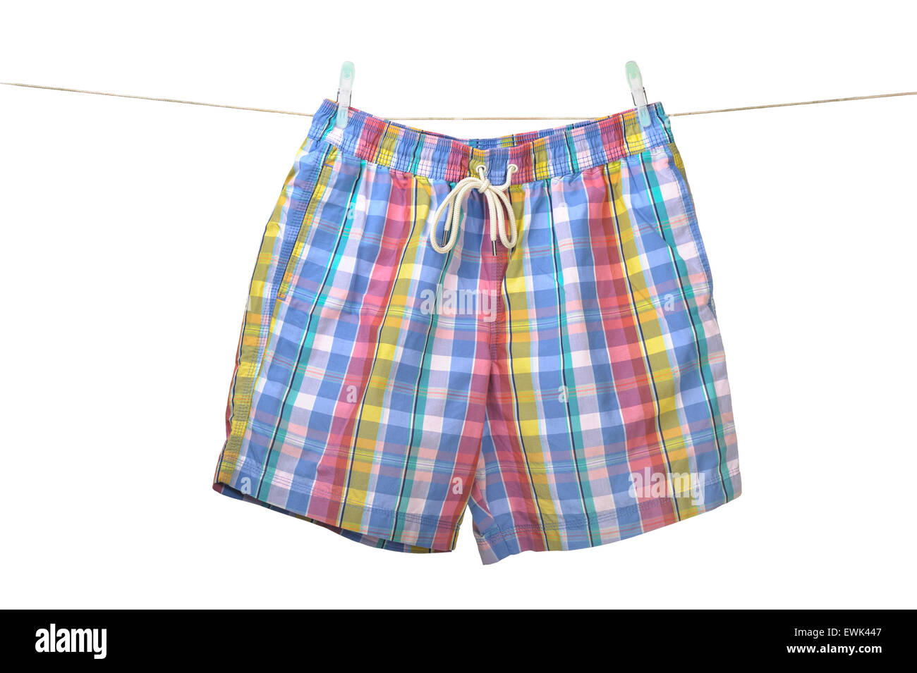 Swim shorts hanging on a washing line. - Stock Image