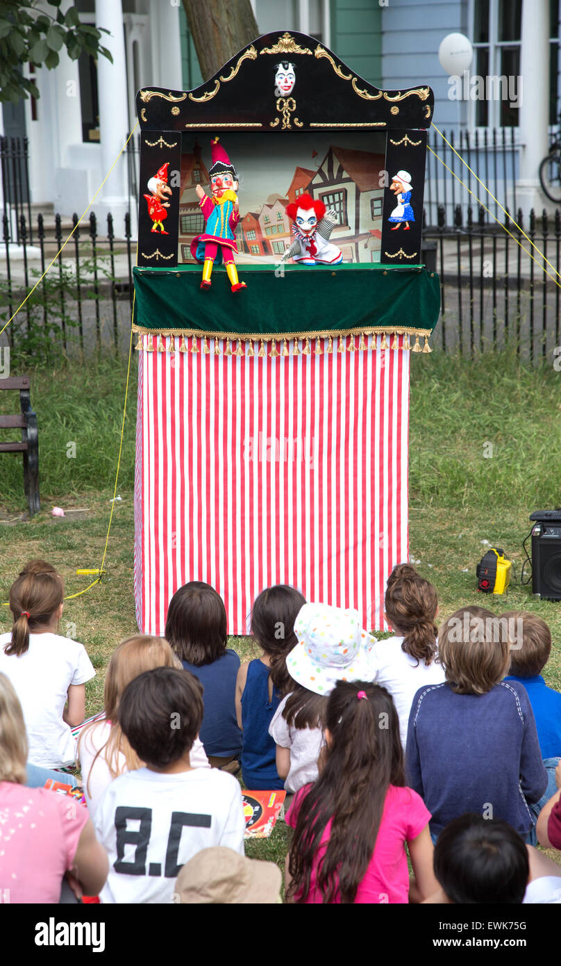 Children watch a traditional Punch and Judy show - Stock Image