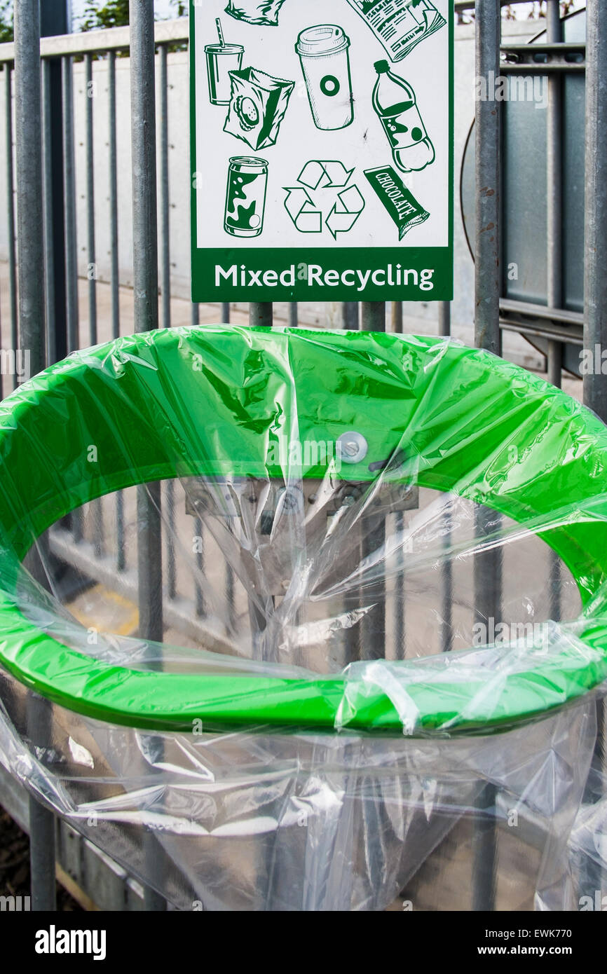 Mixed recycling rubbish bin on platform at Willesden Junction, London, England, U.K. - Stock Image