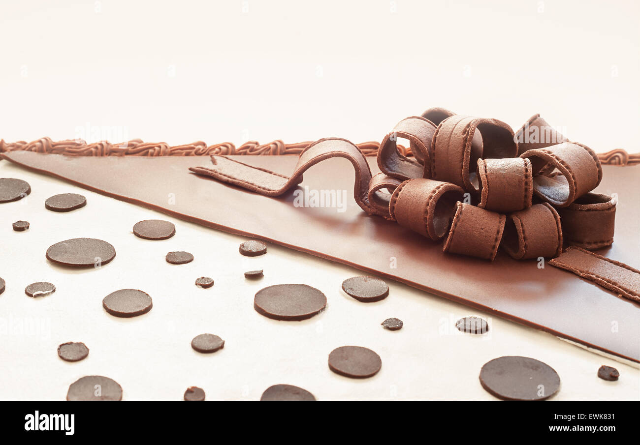Details of a chocolate cake ornaments, pretty ribbon on top. - Stock Image