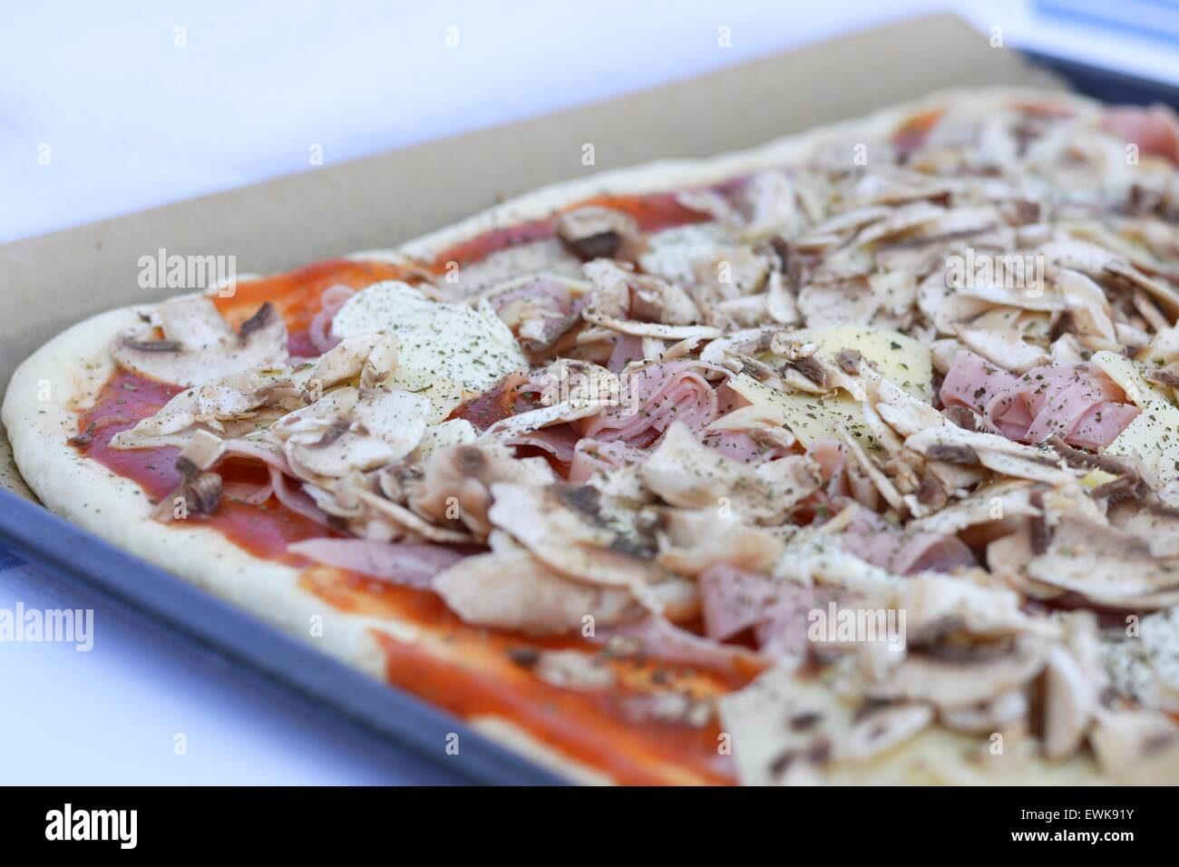 Unbaked pizza - Stock Image