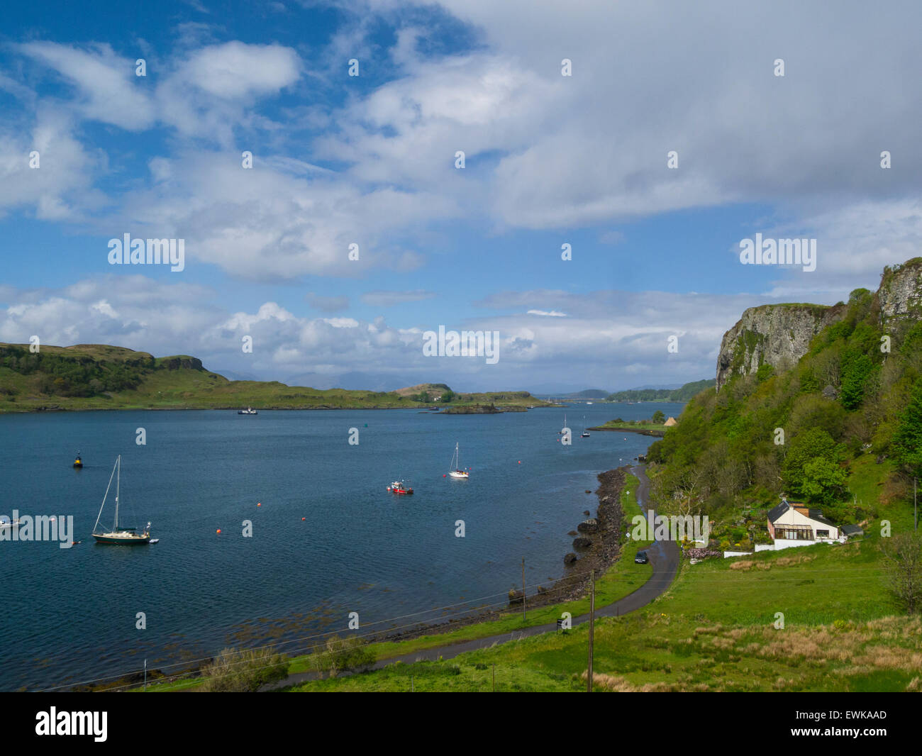 View down to Kerrera Island and yachts moored in Sound of Kerrera popular tourist resort town Oban Argyll and Bute - Stock Image