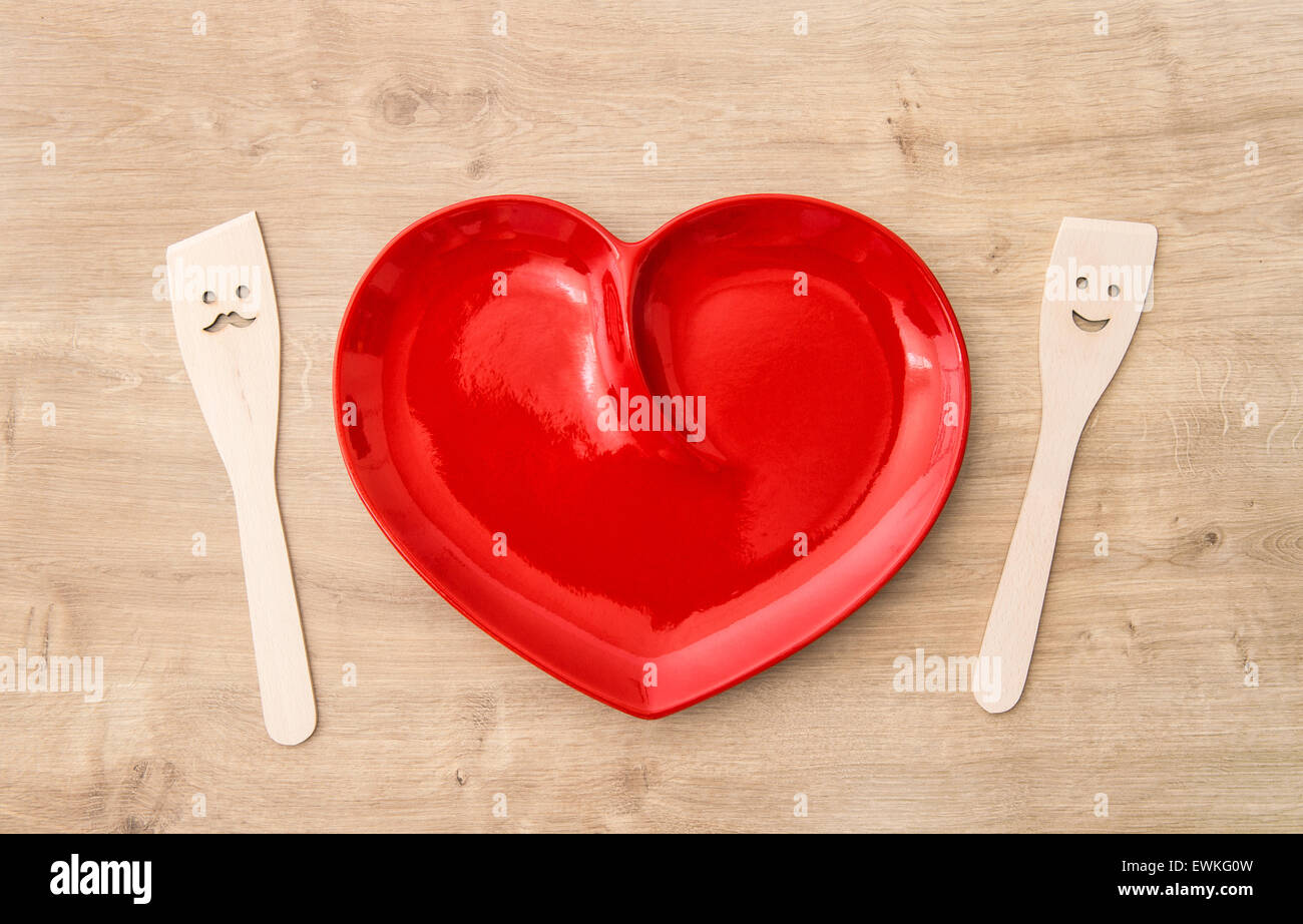 Wooden Kitchen Utensils And Red Tablecloth. Funny Tools For Food Preparation