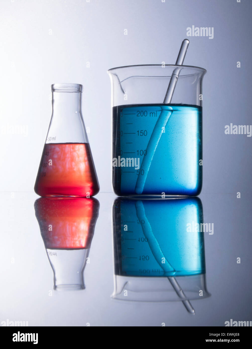 beakers with red and blue chemicals - Stock Image