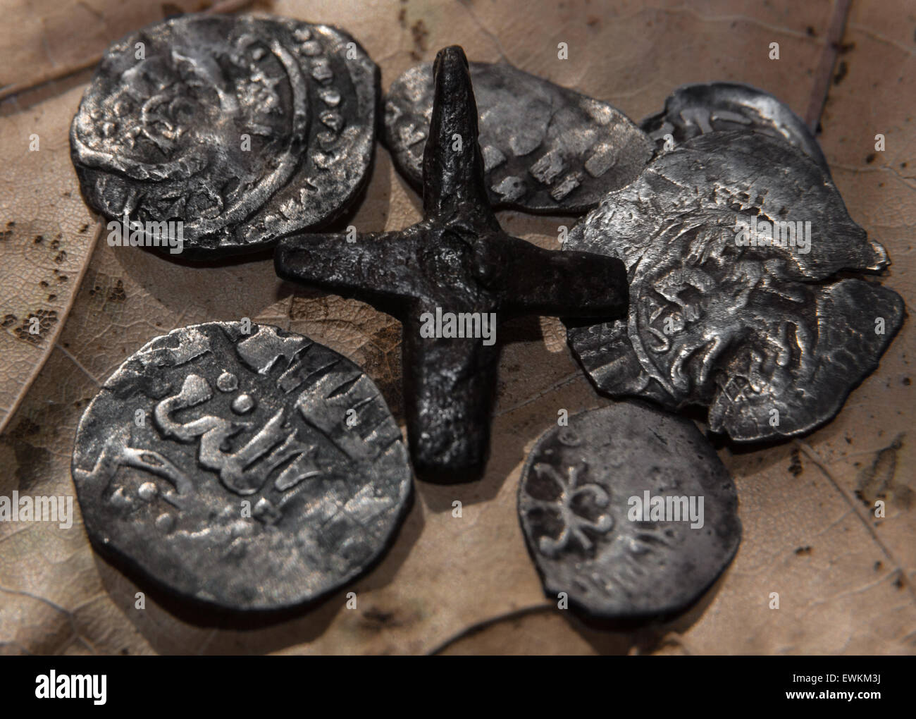 wire Russians and the Arab coins with one iron Christian cross - Stock Image