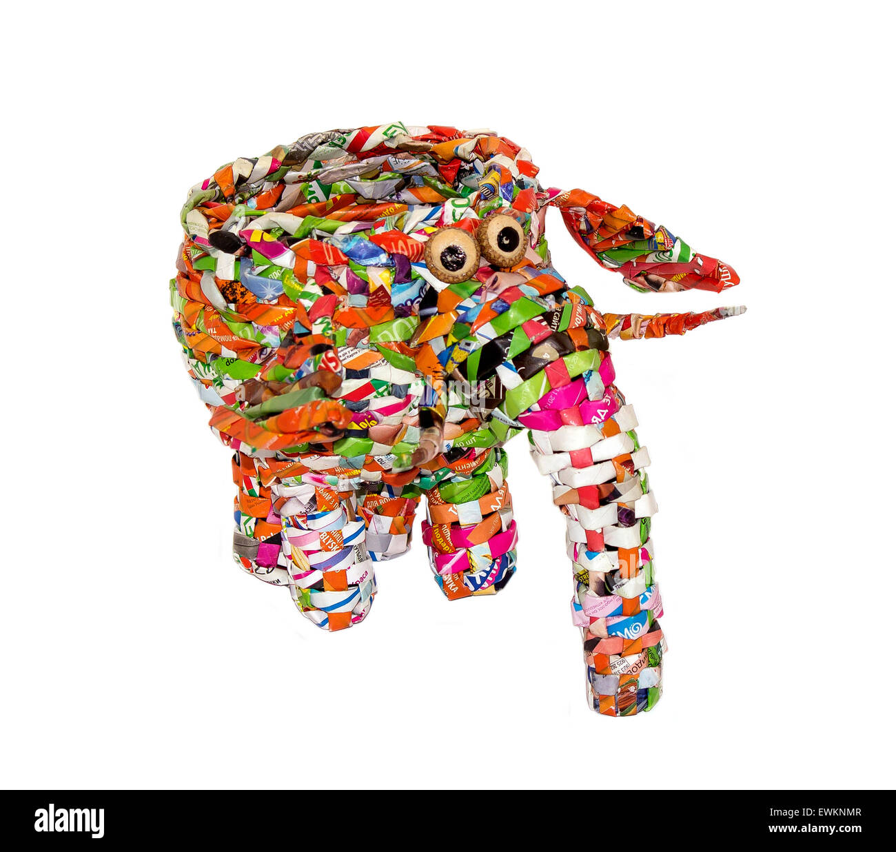 A toy elephant made of candy wrappers on a white background - Stock Image