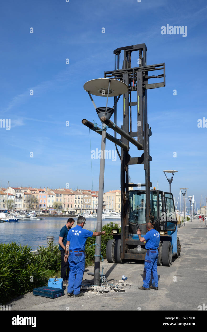 Workers Installing Street Lamp or Street Lighting  La Ciotat Bouches-du-Rhône France - Stock Image