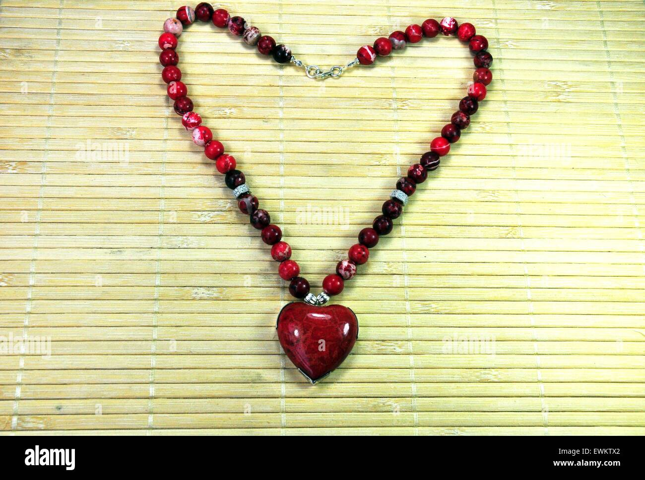 Red necklace with a large heart shaped pendant Stock Photo