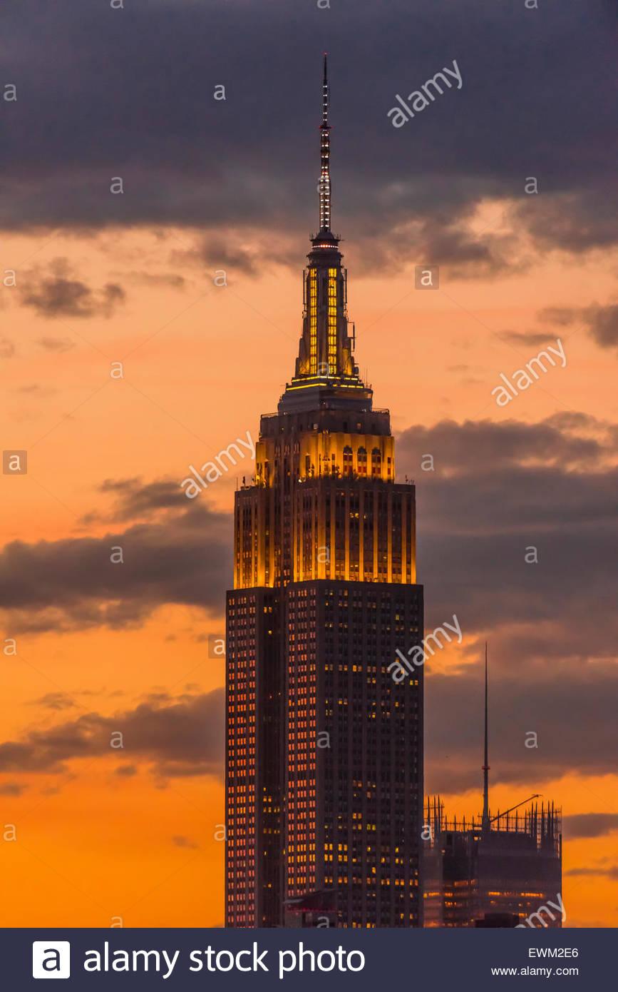 Empire State Building illuminated at twilight, New York, New York USA. Stock Photo