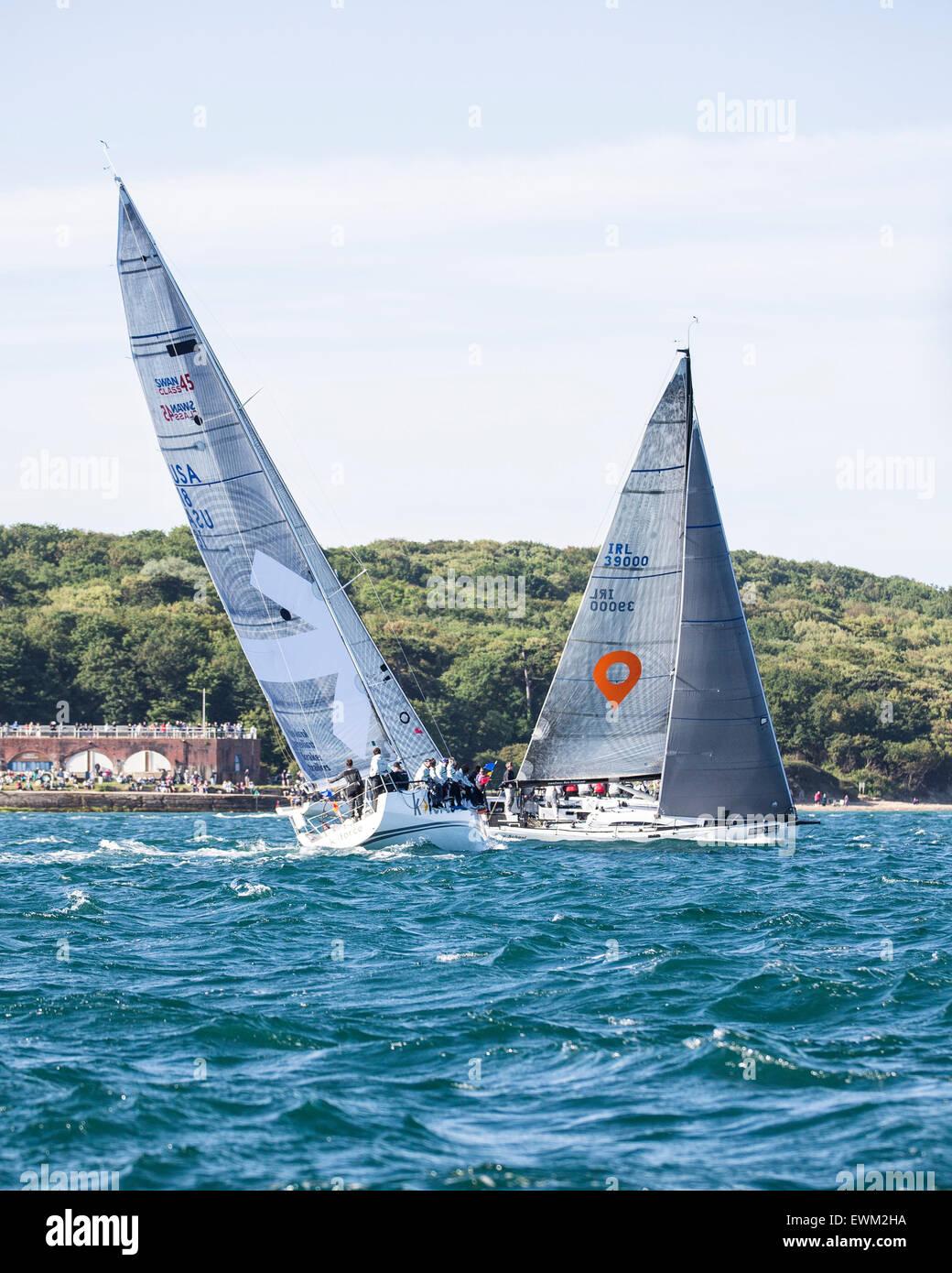 UK. 27th June, 2015. Swan 45 USA 18 'K Force' (nearer) and Mills 59 IRL 3900 'Zero II' off Yarmouth - Stock Image